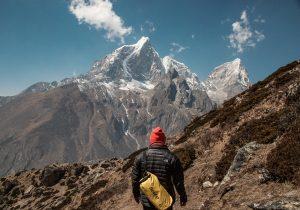 man climbing a mountain-moments of discord